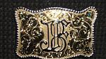 Western style belt buckle and sterling jewelry